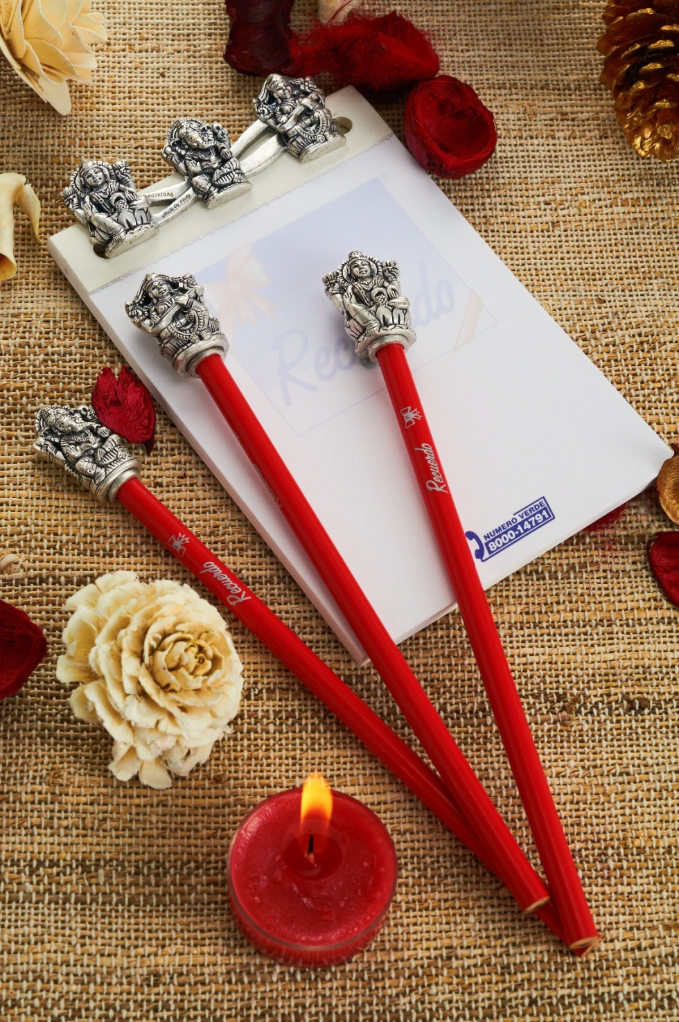 d'mart Exclusif IOTA silver-plated Ganesh and Saraswati pencil, Rs 900 each