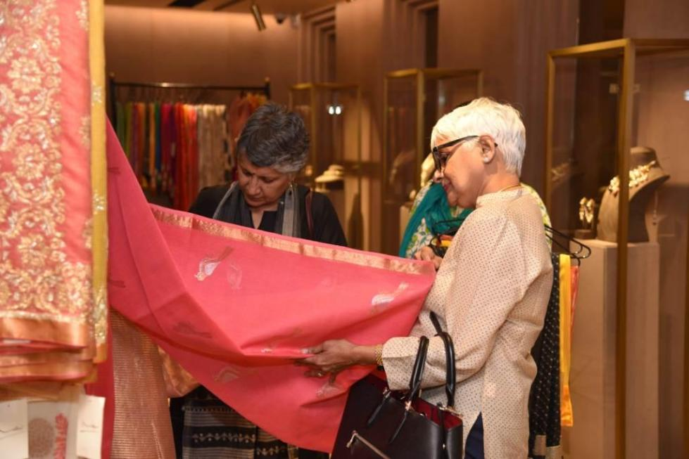 Guest at the event browsing through Vidhi's Collection.