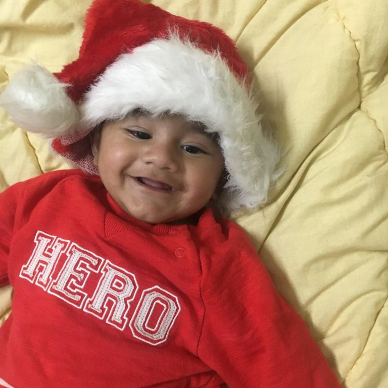 Baby Dhruv in Santa Claus cap.JPG
