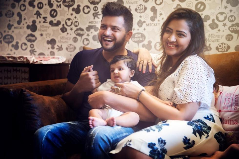 Suresh Raina & Priyanka Raina with their daughter.JPG