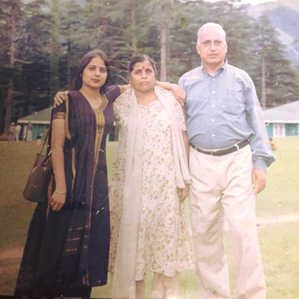 Meenakshi with her parents