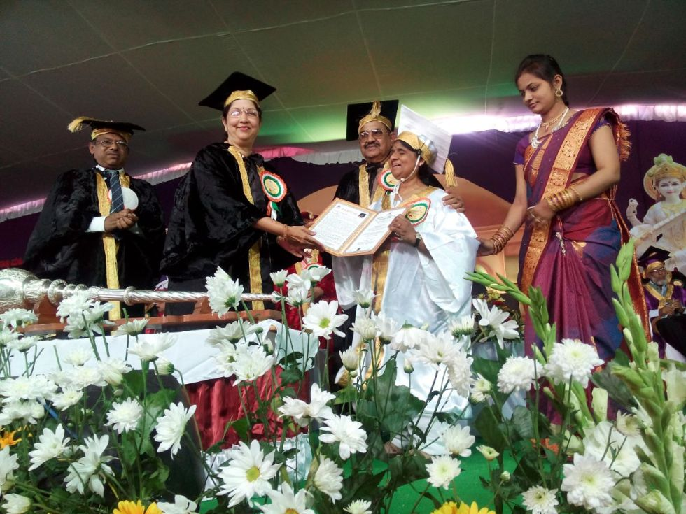 Madhu Singhal receiving doctorate