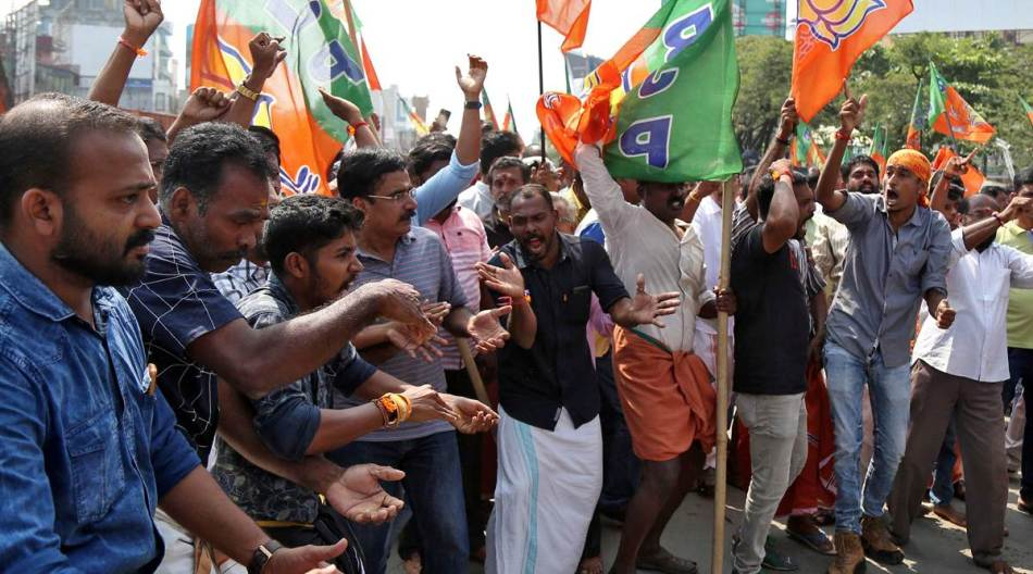 Supporters of India's ruling BJP shout slogans as they block a highway during a protest against the arrest of their leader K Surendran in Kochi