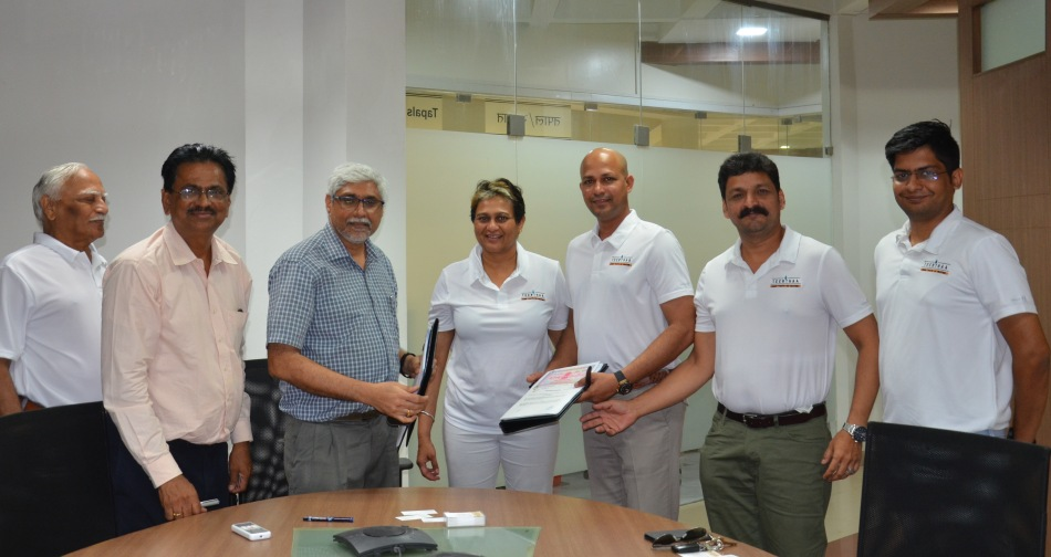 Prof. Ravindra Gettu (3rd LEFT), Dean (ICSR), IIT Madras, & Ms. Durga Das (4th LEFT), CEO of Teerthaa, displaing the MoU on collaboration.jpg